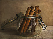 Apple Pie Prints - Cinnamon sticks in a glass jar Print by Elena Nosyreva