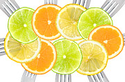 Overlapping Circles Metal Prints - Citrus Fruit Sliced On Forks Metal Print by Lee Avison