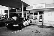 Donut Shop Posters - City Of Florida City Police Patrol Squad Car Parked Outside Dunkin Donuts Shop Usa Poster by Joe Fox