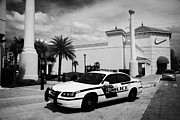 Patrol Car Framed Prints - City Of Orlando Police Squad Patrol Car Outside A Shopping Mall In Florida Usa Framed Print by Joe Fox