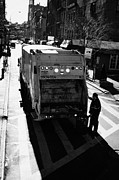 Manual Framed Prints - City Refuse Worker Checks The Back Of A Garbage Truck On A Cross Walk Bleeker St Greenwich Village Framed Print by Joe Fox