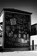 Irish Artists Prints - Civil Rights The Beginning mural as part of the peoples gallery murals in Rossville Street of the bogside area of Derry Londonderry Northern Ireland Print by Joe Fox