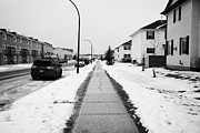 Salted Framed Prints - cleared salted gritted sidewalk in a residential development Saskatoon Saskatchewan Canada Framed Print by Joe Fox