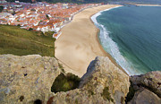 Fishing Village Framed Prints - Cliff of the Seaside Village of Nazare Framed Print by David Letts