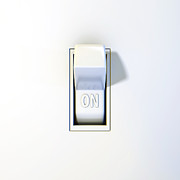 Flip Framed Prints - Close up of a wall light switch in the on position Framed Print by Scott Norris