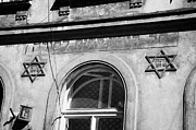 Yiddish Prints - close up of bet hamidrash of Kovea Itim L Tora 1810 building with star of david and writing hebrew symbols krakow Print by Joe Fox