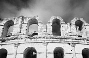 Ancient Rome Art - Close Up Of The Top Of The Old Roman Colloseum Against Blue Cloudy Sky El Jem Tunisia by Joe Fox