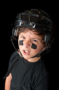 Youth Hockey Photos - Close up of young hockey player by Joe Belanger