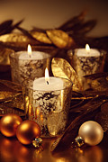 Sandra Cunningham - Closeup of candles lit with a sparkling gold theme