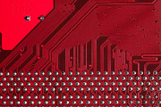 Processor Posters - Closeup of computer circuit board in red Poster by Stephan Pietzko