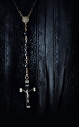 Silver Embroidery Prints - Closeup of prayer beads against black morning dress Print by Sandra Cunningham