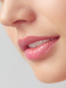 Chin Up Photo Prints - Closeup of woman mouth with pink lips Print by Oleksiy Maksymenko