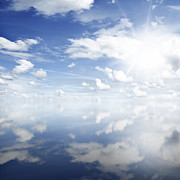 Sky Photos - Clouds reflected by Les Cunliffe