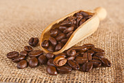 Coffee Beans Framed Prints - Coffee Beans Spilling from a Scoop Framed Print by Colin and Linda McKie