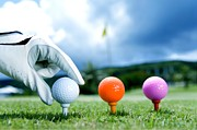 Swing Paintings - Colored golf balls are in the range by Lanjee Chee