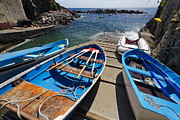 Boats In Harbor Posters - Colorful Boats on a Ramp Poster by George Oze
