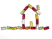 Lebensmittel Prints - Coloured Jellybabies Formed As A House Print by Juergen Ritterbach