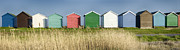 Beach Huts Framed Prints - Colourful Beach Huts Framed Print by Helen Hotson