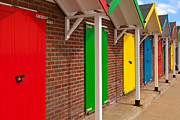 Beach Huts Posters - Colourful beach huts Poster by Richard Thomas