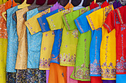 Yellow Green Blue Prints - Colourful girls dresses in India Print by Tim Gainey