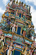 Krishna Posters - Colourful Hindu Temple Gopuram Statues Poster by Tim Gainey