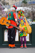 Quirky Posters - Colourfully dressed buskers pause on the way home Poster by David Hill
