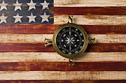 Discoveries Prints - Compass on wooden folk art flag Print by Garry Gay