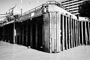 London Pier Framed Prints - concrete piles and wooden stanchions on thames riverbank London England UK Framed Print by Joe Fox