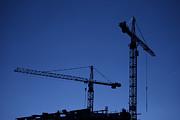 Construction Cranes At Dusk Print by Antony McAulay