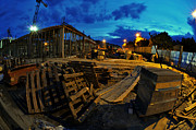 Wooden Building Prints - Construction site at night Print by Jaroslaw Grudzinski