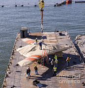 Hard Hats Prints - Contractors Hoist The X-47b Unmanned Print by Stocktrek Images