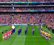 Hurling Prints - Cork and Clare hurling teams Print by Patrick Dinneen