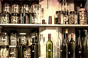 Winebottle Prints - Corks stored in flasks in a cork shop Print by Georgina Noronha
