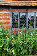 Country Cottage Photos - Country Garden by James Brunker