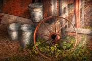 Wheels Photo Framed Prints - Country - Some dented pails and an old wheel  Framed Print by Mike Savad