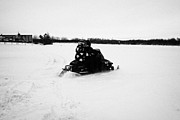 Sask Prints - couple on a snowmobile going cross country Kamsack Saskatchewan Canada Print by Joe Fox