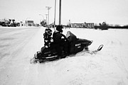 Snowmobile Framed Prints - couple on a snowmobile going off road Kamsack Saskatchewan Canada Framed Print by Joe Fox
