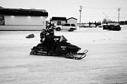 Snowmobile Framed Prints - couple on a snowmobile Kamsack Saskatchewan Canada Framed Print by Joe Fox