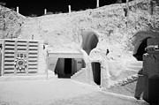 Dug Out Framed Prints - courtyard and steps leading to caves of the Sidi Driss Hotel underground at Matmata Tunisia scene of Star Wars films with film props Framed Print by Joe Fox