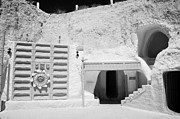 Under Ground Framed Prints - courtyard of the Sidi Driss Hotel underground at Matmata Tunisia scene of Star Wars films with film props Framed Print by Joe Fox