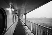 Passenger Ferry Prints - Covered Walkway On Board Hurtigruten Ferry Passenger Ship Docked In Hammerfest During Winter Finnmar Print by Joe Fox