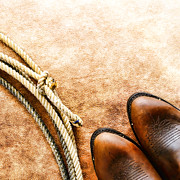 Rodeo Photos - Cowboy Boots and Lasso by Olivier Le Queinec