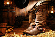 Ranch Framed Prints - Cowboy Boots in a Ranch Barn Framed Print by Olivier Le Queinec