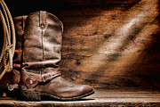 Ranch Photo Prints - Cowboy Boots on Wood Floor Print by Olivier Le Queinec