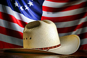 American Cowboy Framed Prints - Cowboy Hat and American Flag Framed Print by Olivier Le Queinec