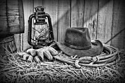 Leather Gloves Prints - Cowboy Hat and Rodeo Lasso in a black and white Print by Paul Ward