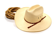 Cowboy Hat Photo Prints - Cowboy Hat and Rope Print by Olivier Le Queinec