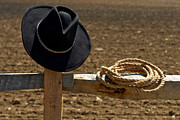 Headwear Prints - Cowboy Hat and Rope on Fence Print by Olivier Le Queinec
