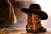 Cowboy Hat Photo Prints - Cowboy Hat on Boots Print by Olivier Le Queinec