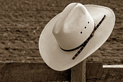 Headwear Prints - Cowboy Hat on Fence Print by Olivier Le Queinec